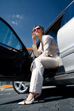 Woman in the car by phoning 1 Stock Photo