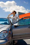 Woman in the car by phoning 2 Royalty Free Stock Images