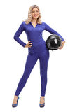 Woman car racer in a blue racing suit. Full length portrait of a woman car racer in a blue racing suit holding a helmet isolated on white background royalty free stock images