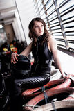 Woman car racer in leather suit holding a helmet Royalty Free Stock Photo