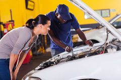 Woman car repair. Young women sending her car for repair in garage Stock Photos
