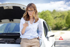 Woman with car on the road Stock Photos