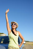 Woman on car roadtrip waving Stock Photo