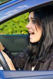 Woman in car screaming getting into accident Stock Image