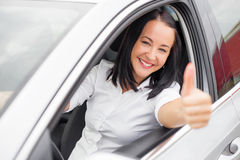 Woman  in the car and showing thumbs up Stock Image