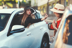 Woman from the car shows indecent gesture. Royalty Free Stock Photos