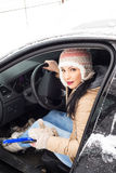 Woman with car in snow Royalty Free Stock Images