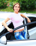 Woman by car Stock Photo