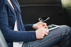 Woman in a Car with a Tablet Royalty Free Stock Photo