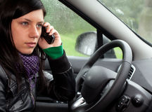 Woman in the car talking on the phone Stock Images