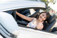Woman in a car with thumbs up Stock Photo
