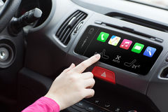 Woman in a car and touch play finger in auto smart system Royalty Free Stock Images