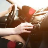 Woman in a car use audio system Royalty Free Stock Image