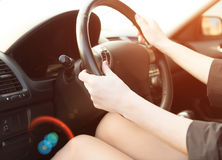 Woman in a car use audio system Stock Photo