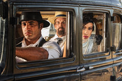 Woman in Car Watching. Three 1920s vintage gangsters in car watching Stock Image