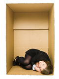Woman in a Carboard Box Royalty Free Stock Image