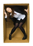 Woman in a Carboard Box Stock Images