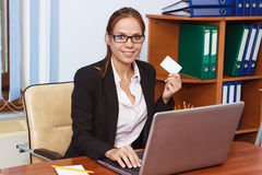 Woman with a card in the hands, business concept Stock Images