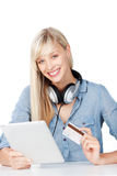 Woman with card and tablet Royalty Free Stock Photography