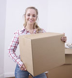 Woman with cardboard box Stock Photography