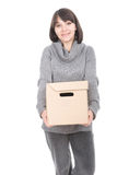 Woman with cardboard box. Young adult brunette woman holding cardboard box. over white background royalty free stock images