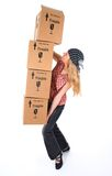 Woman with cardboard boxes ready to fall stock images