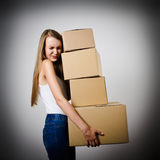 Woman and cardboards. Royalty Free Stock Photography