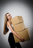 Woman and cardboards. Royalty Free Stock Photos