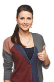 Woman in cardigan gesturing thumb up Royalty Free Stock Image