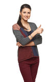 Woman in cardigan gesturing thumb up Royalty Free Stock Photos