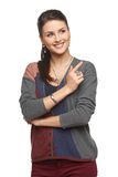 Woman in cardigan pointing at blank copy space Stock Photos