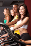Woman on cardio machine Royalty Free Stock Image