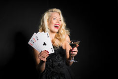 Woman with cards and drink in other hand Royalty Free Stock Photo