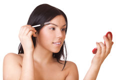 Woman care for her eyebrows Royalty Free Stock Photo