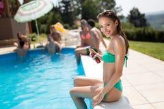 Woman careful not to get sunburn. By applying cream Stock Image
