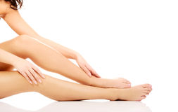 Woman cares about her legs. Royalty Free Stock Photography