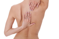 Woman caressing her bare shoulder and back Royalty Free Stock Photos