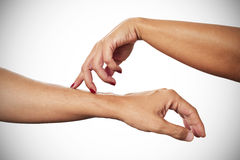 Woman caressing with her fingertips the arm of a man. A young woman caressing with her fingertips the arm of a young man stock images