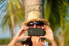 Woman on caribbean travel taking photo Stock Images