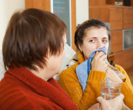 Woman caring for  adult daughter has cough Stock Image