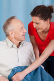 Woman caring about disabled man Stock Photo