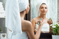 Woman caring for her complexion. Photo of splendid woman caring for her complexion with cosmetics Stock Images