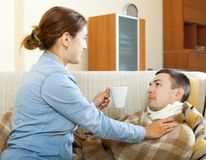 Woman caring for sick husband Royalty Free Stock Photo