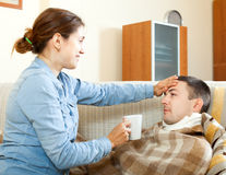 Woman caring for sick man Royalty Free Stock Photos
