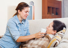 Woman caring for sick mature mother Royalty Free Stock Photo