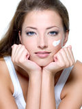 Woman caring of a skin on face Royalty Free Stock Photography