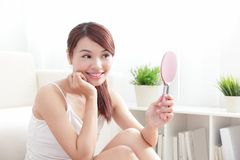 Woman caring skin and face by mirror Royalty Free Stock Images