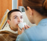 Woman caring for unwell husband Stock Image