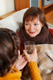 Woman caring for unwell senior mother Stock Photography