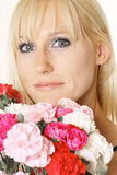 Woman with carnations Royalty Free Stock Photo